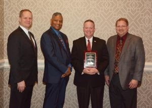 Pictured left to right: Kevin Kissling, Eastern National president and CEO; Calvin Wilson, Families of Flight 93 board member and family member of Flight 93 hero, LeRoy W. Homer, Jr.; Stephen Clark, superintendent of the National Parks of Western Pennsylvania; and David Wagner, EN Mid-Atlantic regional manager. Stephen accepted the Charles S. Marshall Unit Award on behalf of Flight 93 N MEM.