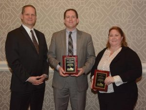 EN President and CEO Kevin Kissling (left) presents Dedicated Service Awards to Donald Leadbetter and Alexa Viets.